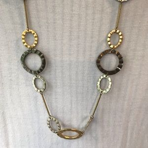 Gold, silver and platinum necklace